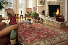 Photo Of Hardwood Flooring With Rug In Den - Speedwell Design Center