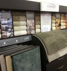 Photo Of Multi-Colored Carpets Samples Display In Flooring Store - Speedwell Design Center