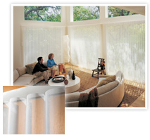 Couple sitting in living room with window shades from Hunter Douglas installed by Speedwell Design Center in NJ